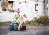 Woman with Pink Hair and a Small Siuitcases — Stock Photo