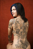 Woman with a tattoo on her back — Photo