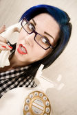 Pretty young woman on the phone — Stockfoto