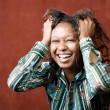 Stock Photo: Laughing African-AmericWoman
