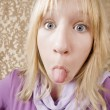 Young girl sticking out her tongue — Stock Photo #39620697
