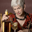 Stock Photo: Eldery alcoholic woman