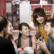 Stock Photo: Friends in a Coffee House