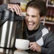 Stock Photo: Coffee Crazed Young Man