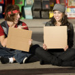 Young Man and Woman with Blank Cardboard Signs — Stock Photo #39627697