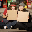 Young Man and Woman with Blank Cardboard Signs — Stock Photo #39627703