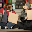 Young Man and Woman with Blank Cardboard Signs — Stock Photo #39627719