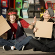 Young Man and Woman with Blank Cardboard Signs — Stock Photo #39627761