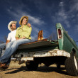 Cowboy and womon pickup truck — Stock Photo #39628763