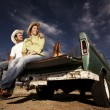 Cowboy and womon pickup truck — Stock Photo #39628765