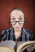 Woman with big eyes reading a book — Stock Photo