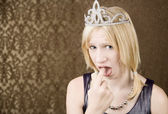 Pretty young girl with a tiara showing disgust — Stock Photo