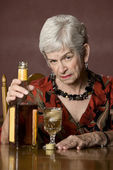 Eldery alcoholic woman — Stock Photo