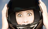 Woman with a motrcycle helmet and surprised expression — Stock Photo