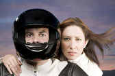 Man and woman on a motorcycle — ストック写真