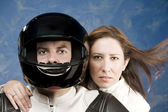 Man and woman on a motorcycle — Photo