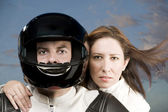 Man and woman on a motorcycle — Stock Photo