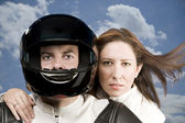 Man and woman on a motorcycle — Zdjęcie stockowe