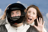 Man and fearful woman on a motorcycle — Stock Photo
