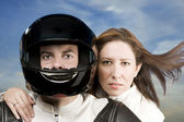 Man and woman on a motorcycle — 图库照片