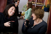 Two women in a coffee house — Stock Photo