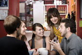 Friends in a Coffee House — Stock Photo