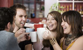 Young Friends Toasting with Coffee Cups — Stok fotoğraf