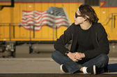Boy with glasses in front of boxcar — Stock Photo