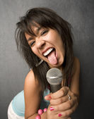 Beautiful Young Singer Sticking Out Her Tongue — Stock Photo