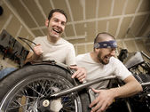 Laughing Motorcycle Mechanics — Stock Photo
