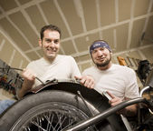 Two Motorcycle Mechanics Placing a Fender — Stock Photo