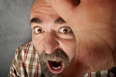 Closeup of man in his 40s screaming — Stock Photo