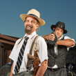 Stock Photo: Easygoing Gangster with Guard
