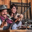 Smiling Sheriff Points Gun With Woman — Stock Photo