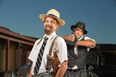 Easygoing Gangster with Guard — Stock Photo