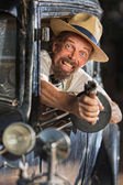 Bearded Gangster Shooting From Car — Stock Photo