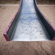 Stock Photo: End of battered old slide