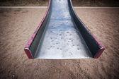 End of a battered old slide — Stock Photo