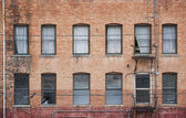 Many windows on old building — Stock Photo
