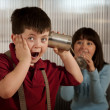 Little boy getting shocking message on tin can phone — Stockfoto #39760065