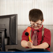 Nerdy boy smashing his computer — Stock Photo