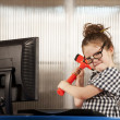 Stock Photo: Nerdy girl smashing her computer