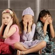 Stock Photo: Three kids ignoring evil