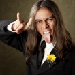 Handsome man in formalwear sticking oput his tongue — Stock Photo