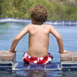 Boy on the edge of a swimming a pool — Stock Photo