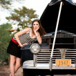 Girl in stripes with vintage car — Stock Photo