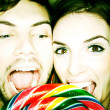 Stock Photo: Couple Biting into Lollipop