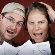 Stock Photo: Couple with too many bills