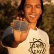 Handsome young man with small solar panel — Stock Photo