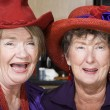 Two Senior Women Wearing Red Hats — Stock Photo #39769405